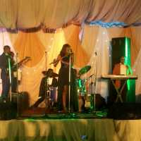 Photos: Nigeria's Foremost Minstrel Ebele The Flutist Rocks Gorgeous High-Low Black Dress For Her Performance At Sinach's Wedding